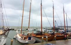 Volendam harbor with Marken in the distance